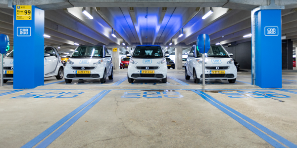 Customers can either pick up or park car2go's electric fortwo cars at the parking hub, walking...