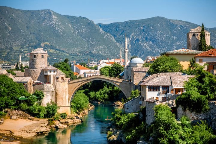Located in the Balkans, Bosnia and Herzegovina is surrounded by mountains, numerous medieval castles, rivers, and water falls. - Photo via Depositphotos.