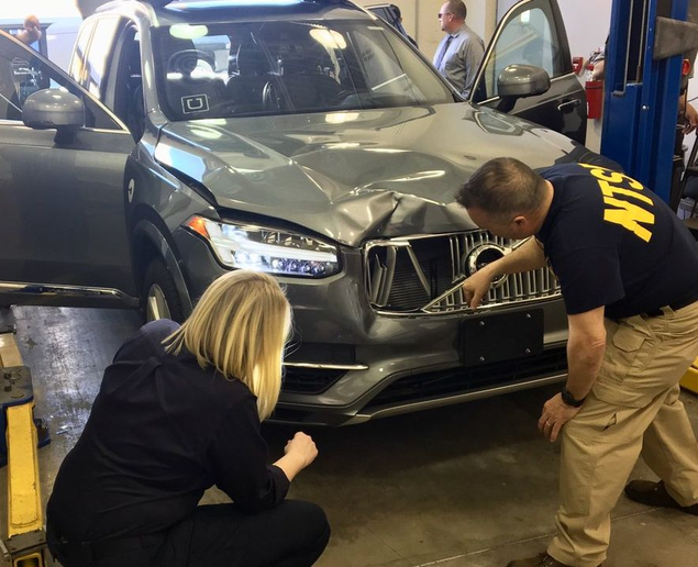 - Uber originally halted its autonomous vehicle testing nationwide following the March incident, when a self-driving vehicle, which was in autonomous mode at the time, struck and hit a pedestrian crossing the street. Here, National Transportation Safety Board officials inspect the vehicle involved in the accident. Photo via NTSB/Wikimedia
