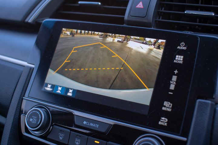 These accident avoidance systems, which include blind-spot monitors, backup cameras, driver monitoring systems, and automatic braking systems, will all function to lower accident rates and save lives. - Photo via Depositphotos.
