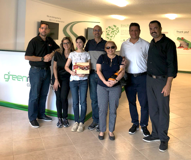 The first customers at Green Motion's Fort Lauderdale's location all received a welcome gift, including champagne and chocolate. - Photo courtesy of Green Motion.