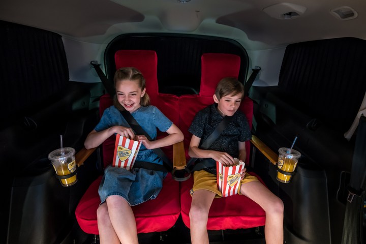 The exclusive Hertz Cinema Car, currently available in the U.K. until the end of the year, comes with an ultra-thin 42-inch screen, illuminated by LED lights, a red, cinema-style, velvet curtains, and surround, cinema-like sound. - Photo courtesy of Hertz.