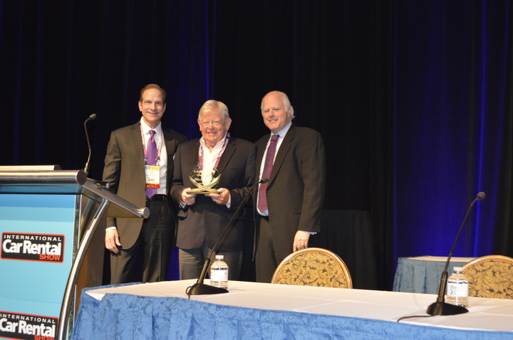 Bill Plamondon (center)was presented the 2019 Impact Award byScott Lieberman (right), chief administrative officer of Advantage and E-Z Rent a Car. - Photo by Shantell Guerra.