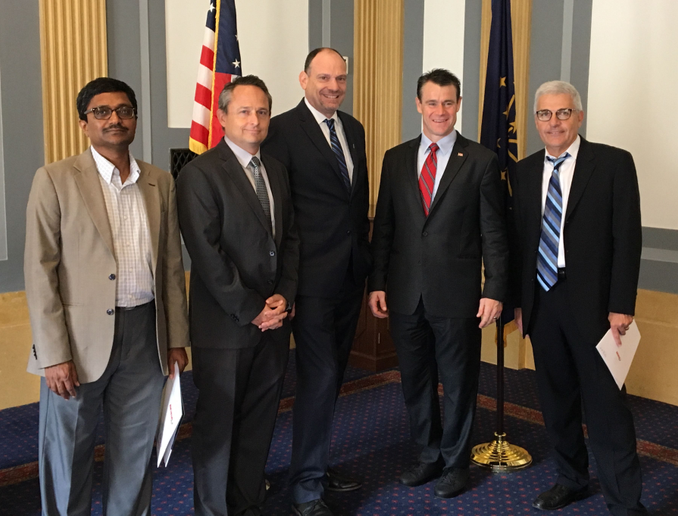 In red tie, Senator Todd Young (R-IN) is flanked (l-r) by Manjunatha Kunigal of Sathvik Systems; Chris Brown, Auto Rental News; Phil Spink, Tom Wood Auto Group and Sixt Car Rental; and Gary Fulena, PurCo Fleet Services.  - Photo courtesy of Todd Young's legislative staff.