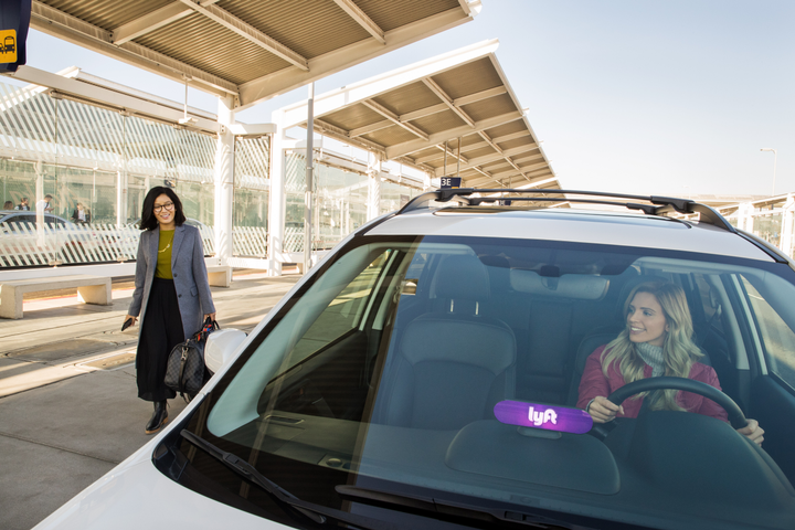 The enhanced verification process will combine driver's license verification and photographic identification. - Photo via Lyft.