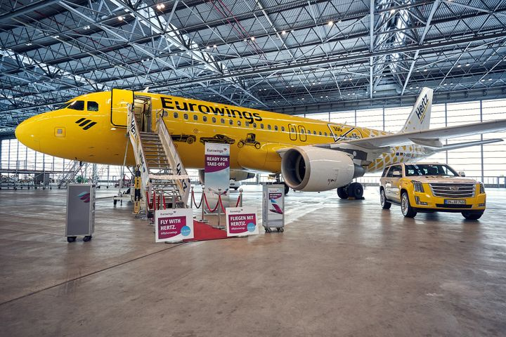 The reveal of the new livery took place at Düsseldorf, Germany airport this week in a ceremony that celebrated the companies' joint commitment to provide the carrier's passengers witha superiorcustomer experience in the air and on the ground. - Photo via Eurowings.
