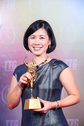 Angeline Tang, regional director for leisure, travel, and partnerships at Avis Budget Group, Asia, accepting the award.  - Photo courtesy of Avis Budget Group.