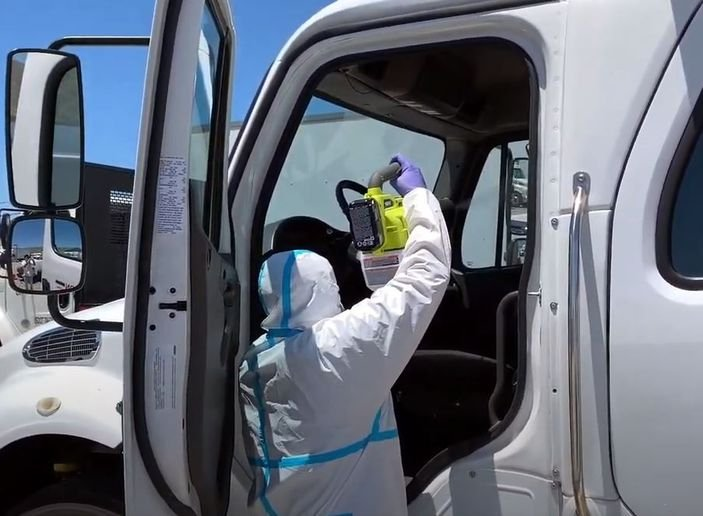 An Avon agent in PPE uses a fog machine to disinfect the cab with an environmentally safe dissolved chlorine dioxide gas. - Photo courtesy of Avon.