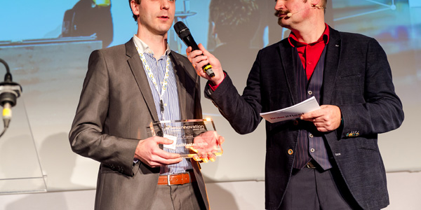 Frederik De Witte, FleetMaster co-founder, accepts first place innovation award at the...