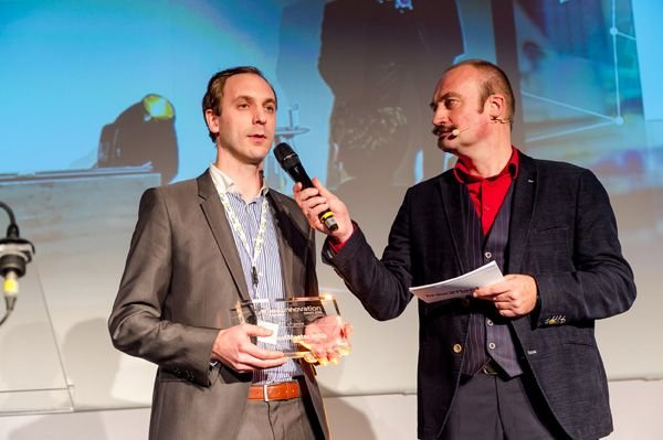 Frederik De Witte, FleetMaster co-founder, accepts first place innovation award at the Link2Fleet event in Brussels, Belgium.  - Photo courtesy of FleetMaster.
