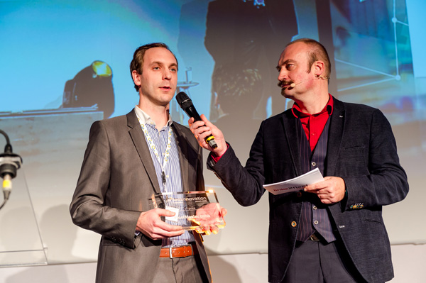 Frederik De Witte, FleetMaster co-founder, accepts first place innovation award at the Link2Fleet event in Brussels, Belgium.  