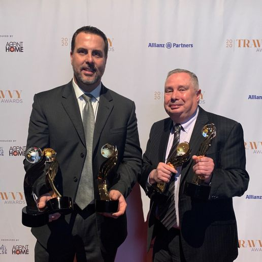 Jay Pope and Tony Cosenza of Enterprise Holdings accept the Travvy Awards in New York City on Feb. 12. - Photo via Enterprise.