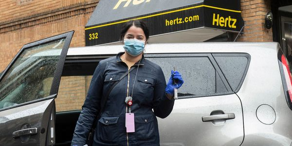 A healthcare worker picks up their car from Hertz in New York City March 28.
