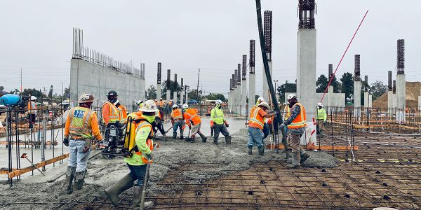 Workers pour the first slab-on-grade at the quick turn around facility.