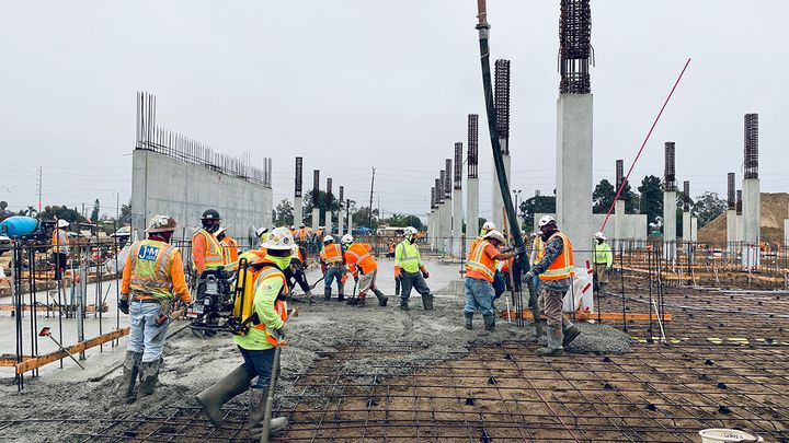 Workers pour the first slab-on-grade at the quick turn around facility. - Photo courtesy of LAX.