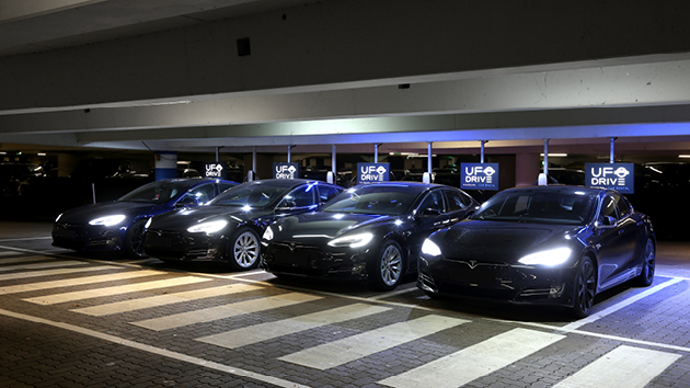 Travelers arriving at the airport can rent one of six Tesla Model S through the UFOdrive app.