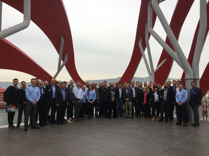 The United MileFleet Roadshow car rental operator and supplier attendees gather on the roof of the Petersen Automotive Museum in Los Angeles. - Photo by Chris Brown.