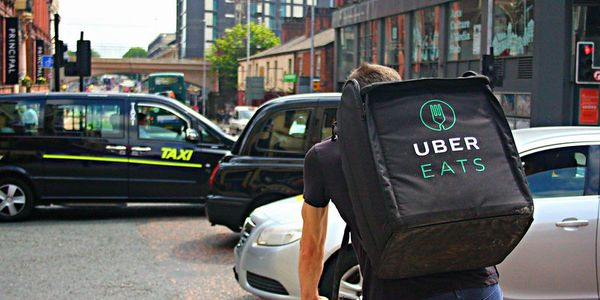 U.S.-based drivers can sign up through the driver app to deliver food for Uber Eats or transport...