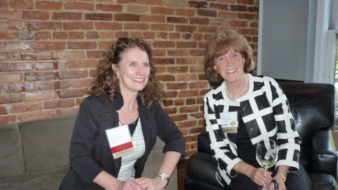 Leslie Pujo of Plave Koch PLC and Leslie Saunders of Leslie Saunders Insurance smile for the...