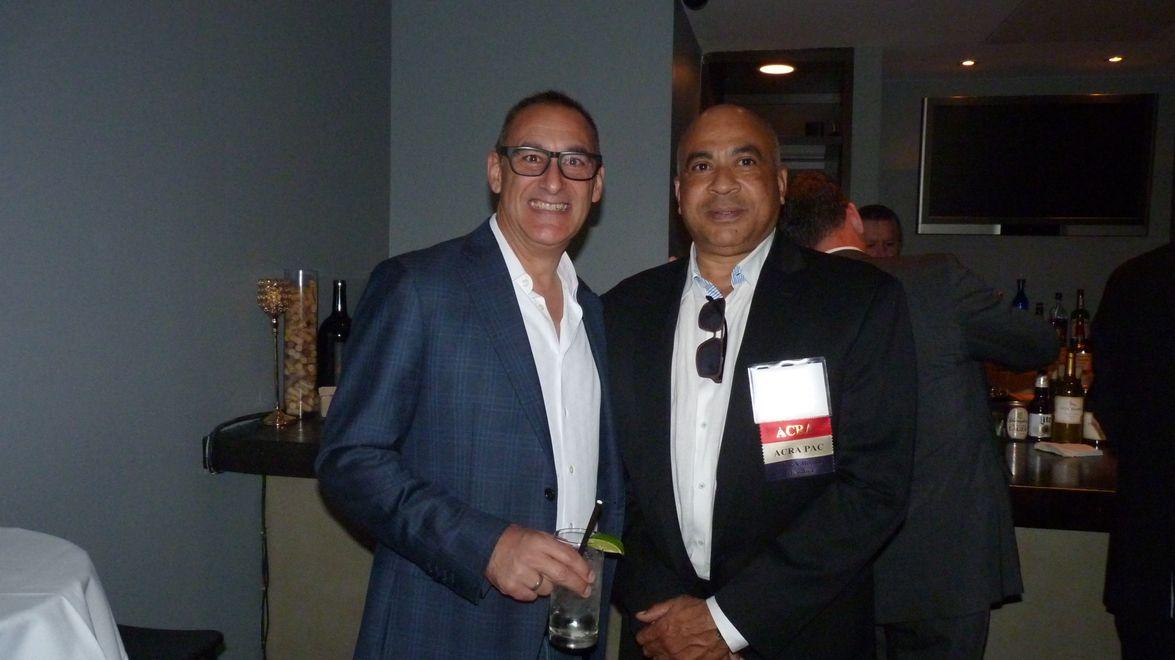 Rudy Callegari (left) poses William Harris of Edge Auto Rental.