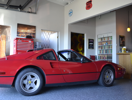 The 1987 Ferrari 328 GTS parked inside the shop.