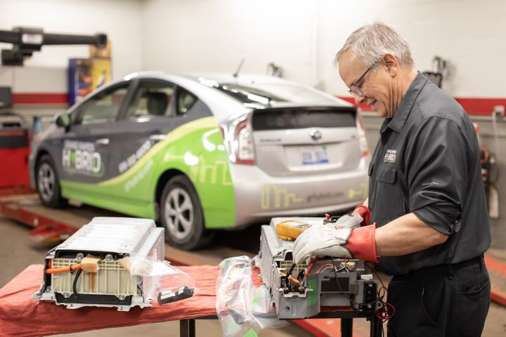 Hybrid guru Eric Carlson servicing hybrid batteries. Eric is well established as the area's expert on hybrid vehicles. Courtesy of Amanda Montgomery -