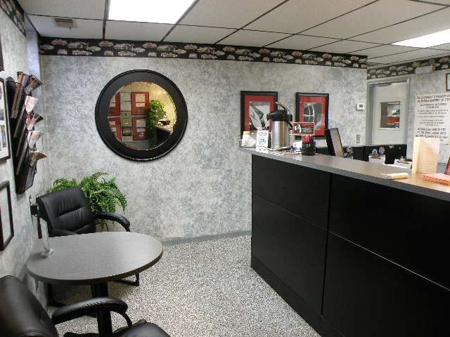 The shop's customer lobby is clean and tastefully decorated. -