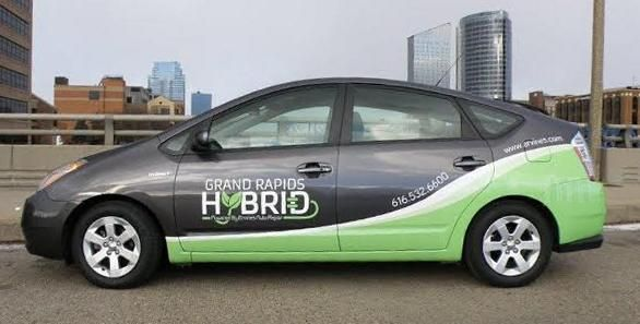 Ervine's house Prius touts the Grand Rapids Hybrid division of the business. -