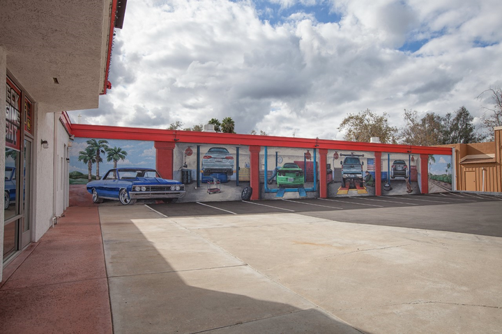 "All I can say is ""wow""! One side of the shop exterior features a series of life-size murals of vehicles in service bay settings. The 1967 Chevelle at the far left is a real eye-catcher. -"