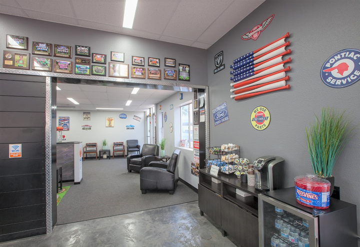 "The shop's customer waiting area earned a second-place award in ASA's recent ""Best Waiting Area"" contest. Notice the creative American flag replica made with 13 baseball bats. -"