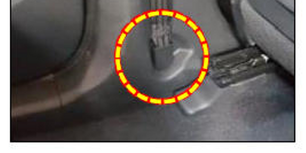 Note the location of the driver's seat belt anchor bolt.
