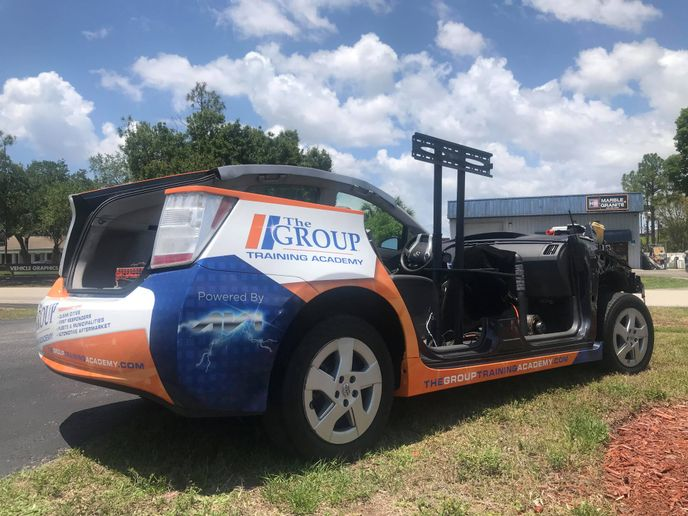 A modified Toyota Prius was developed to offer students a chance to interact with non-energized, high voltage components and learn the proper techniques and personal protective equipment needed for a safe environment. -