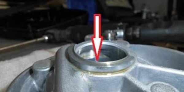 Inspect the bearing bridge for damage. Example of lip protruding from bearing surface is shown here.