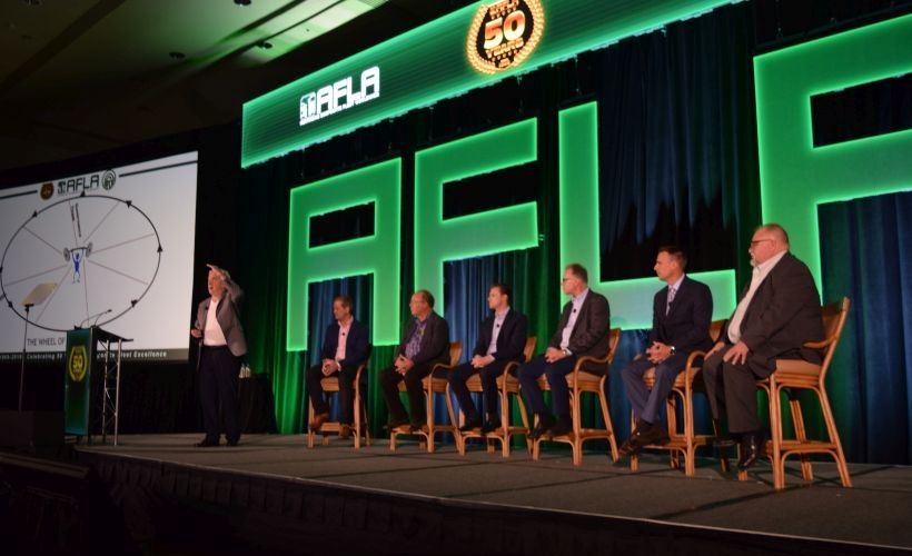 John Dmochowsky (far left) speaks during a panel on global fleet management strategies and...