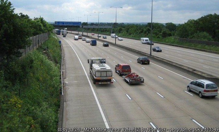 The WLTP requires manufacturers to ensure that passenger cars and new light commercial vehicles, weighing roughly less than 26,455 pounds, meet a new required emissions standard before they are able to legally sell the vehicle in Europe, and it went into effect at the beginning of September.  - Photo of a highway near Byfleet, England, courtesy of Nigel Cox via Wikimedia Commons.