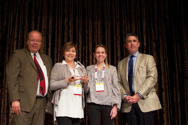 Automotive Fleet editor, Mike Antich (l) and Mike Joyce (r), AALA executive director, presented Dina Kushaliyeva (center left) with the fleet safety award. Kushaliyeva accepted the award with Abigail Bogle (center right), who Kushaliyeva described as an integral part of her fleet safety team.  - Photo by Eric Gandarilla.