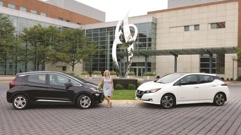 Barbara Zuroick, U.S. fleet and safety manager for AstraZeneca, with a Nissan Leaf and Chevrolet...