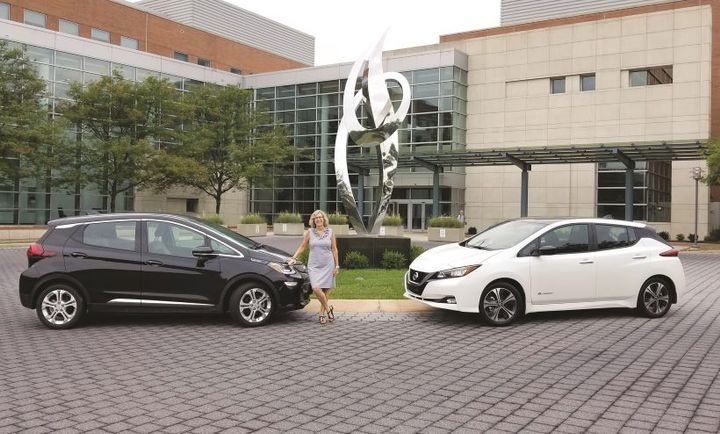 Barbara Zuroick, U.S. fleet and safety manager for AstraZeneca, with a Nissan Leaf and Chevrolet Bolt during a EV test drive experience at the company's Wilmington Del. headquarters. - Photo: AstraZeneca