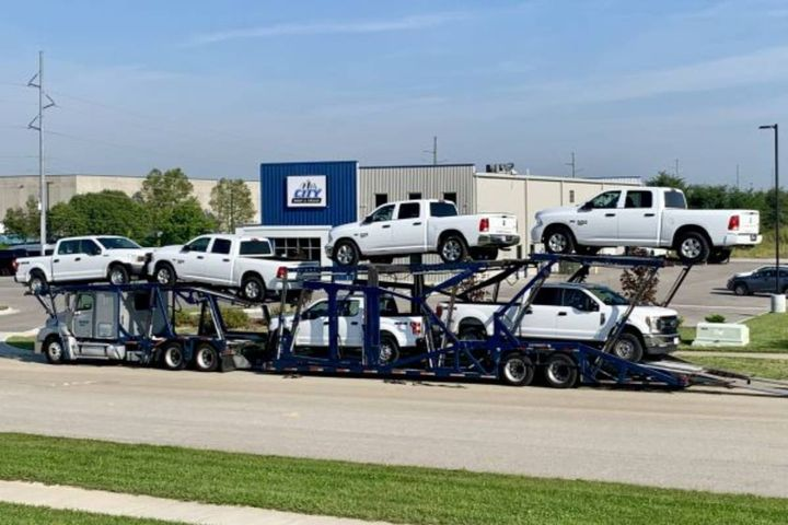 """City Rent a Truck, a national fleet supplier headquartered in Kansas City, takes delivery of new pickups. James McKinley, director of operations, says the company needs to balance the needs of longtime customers. """"[The situation of] little inventory and high rates won't last forever,"""" he says. - Photo: City Rent A Truck"""
