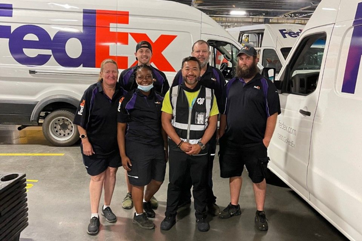 Jeb Lopez(center)congregates withhis teamatWheelzUp, a last-mile delivery service that has contracts with FedEx and Amazon. Lopezjust boughtfour new Nissan NV 2500 cargo vans.He says there were six other buyers waiting for those unitsand they were willing to pay an additional $1,000 to $2,000 more. - Photo: Jeb Lopez, Wheelz Up