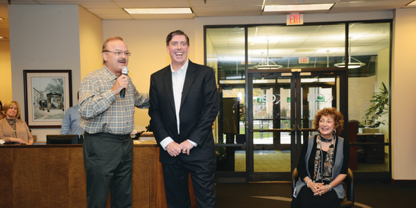 (L-R) Wayne Smolda, chairman of the board for The CEI Group, introduces John Wysseier as the new...