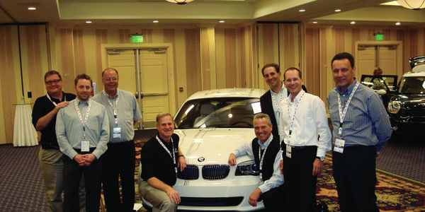 The BMW fleet sales team, along with members of the BMW international sales team, pose before...