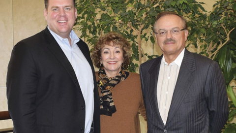 President and CEO of The CEI Group Wayne Smolda (right), Claudia Smolda (center), and the rest...
