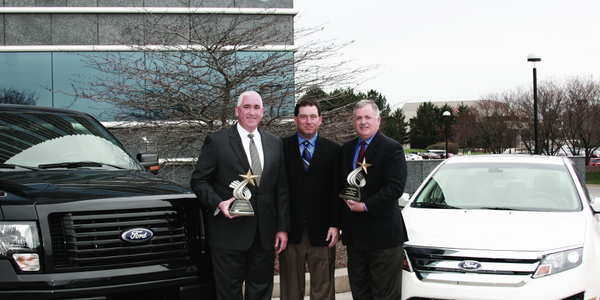AF's Bob Brown (center), Great Lakes sales manager, presented the Fleet Car & Truck of the Year...