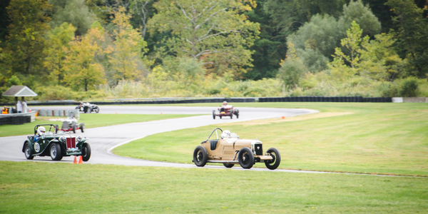 Photo of vintage racing at Lime Rock Race Way courtesy of Ashley Enns Photography.