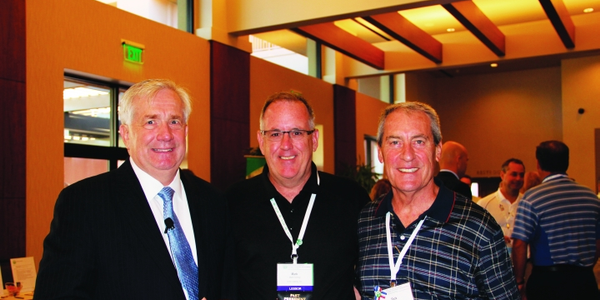 During the AFLA Conference, Malcom (far right) took a moment to catch up with AFLA President...