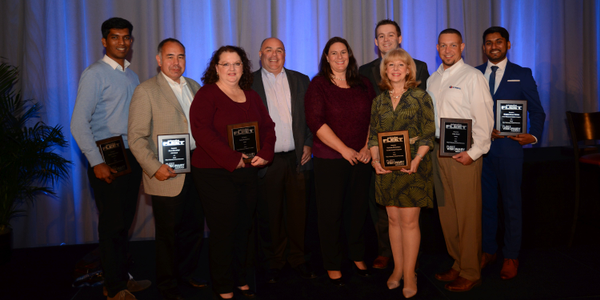 Merchants Fleet Management's Dan Hannan and Tracy DuRocher (center) pose with some of the 2016...