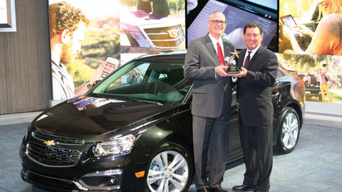 Bob Brown Jr., Great lakes sals manager for Automotive Fleet (right), presented the 2014 Fleet...