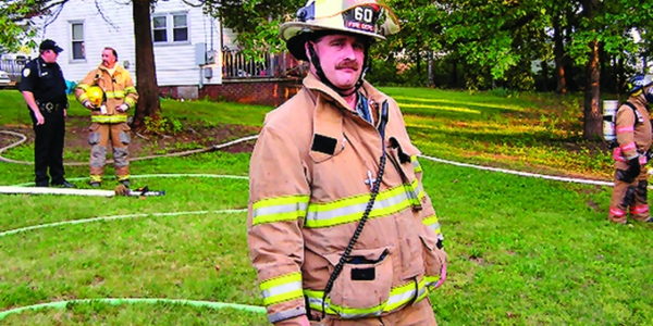 In his 20 years fighting fires and helping others in Mayodan, N.C., Bryant Garner (right) has...