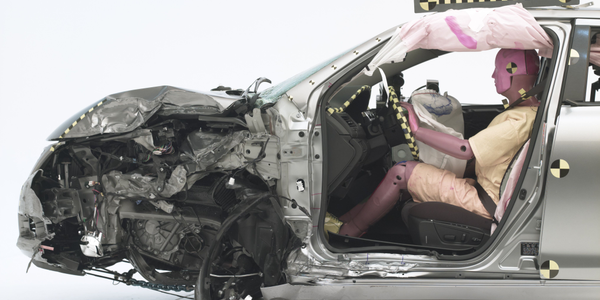 The dummy's position in relation to the door frame, steering wheel, and instrument panel after...